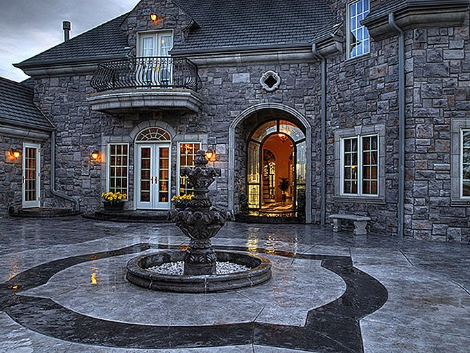 Traditional Exterior Of Home With French Doors, Fountain, Transom Window,  Arched Window,