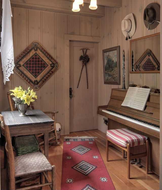 Country Living Room With Chandelier 7271 Afghan Moshwani Runner Rug Hardwood Floors Exposed