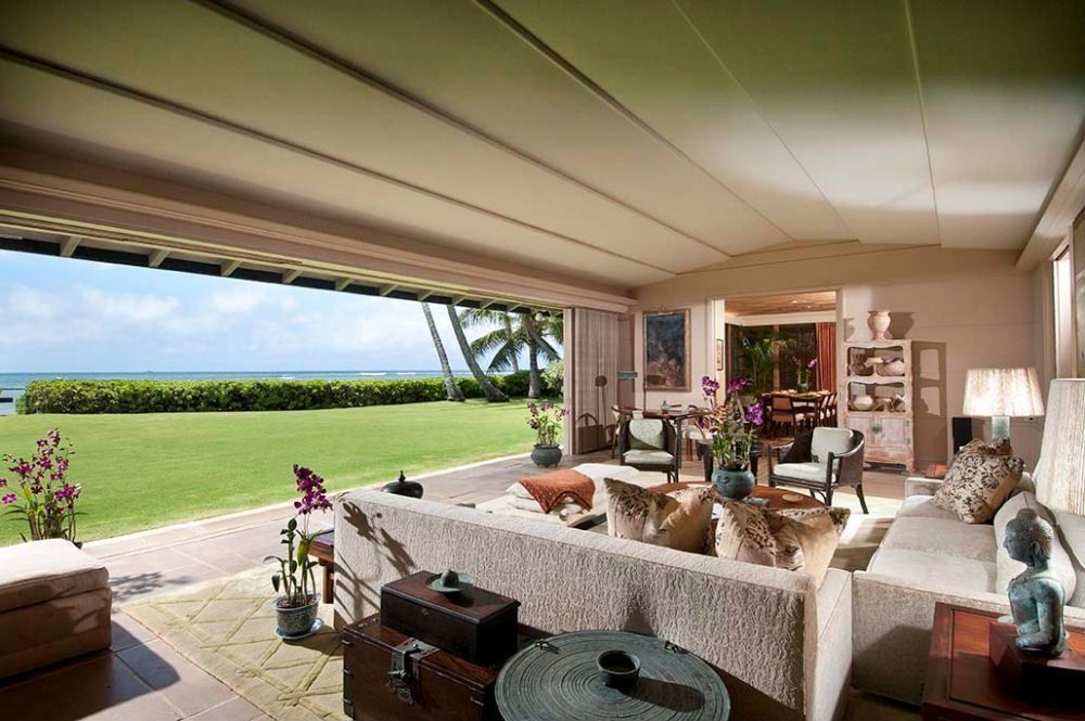 Tropical Living Room with sandstone tile floors in Honolulu, HI ...