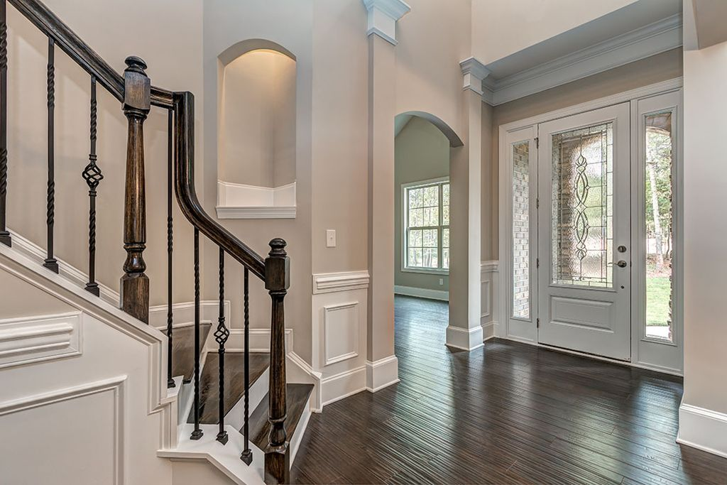 Traditional entryway with hardwood floors wainscoting in for High ceiling entryway