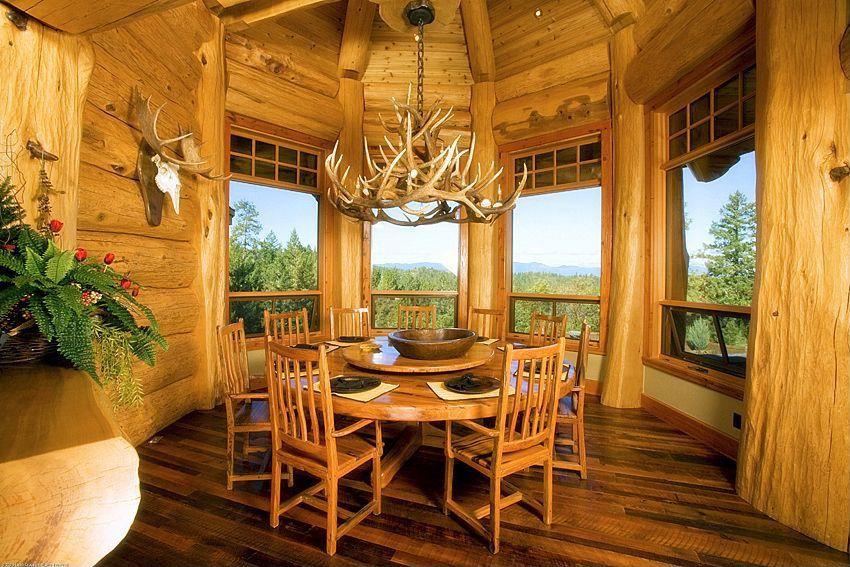 Rustic Dining Room With Columns Aspen Antler Chandelier 40 Hardwood Floors