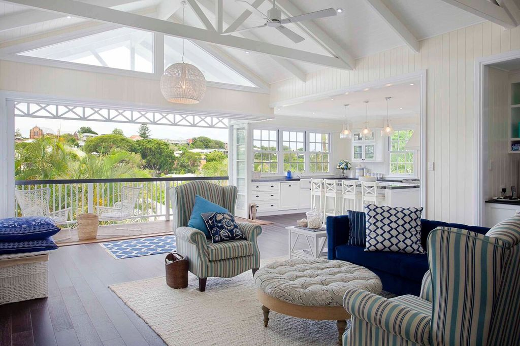 Cottage Living Room With Pendant Light Cathedral Ceiling Exposed Beam Carpet Hardwood