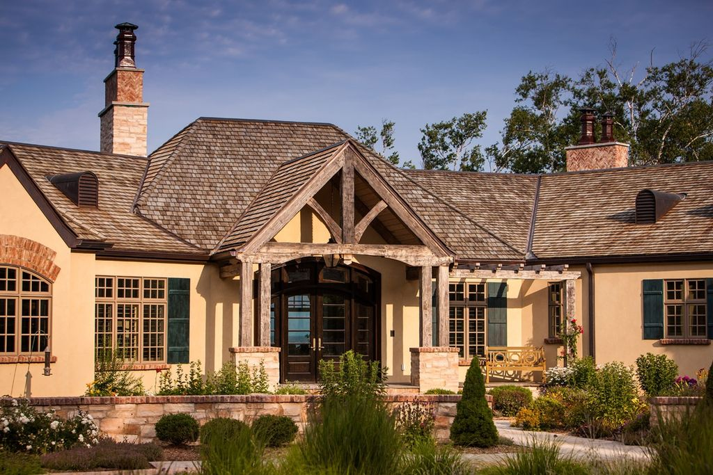 Country Exterior of Home by Mitch Wise Design Inc
