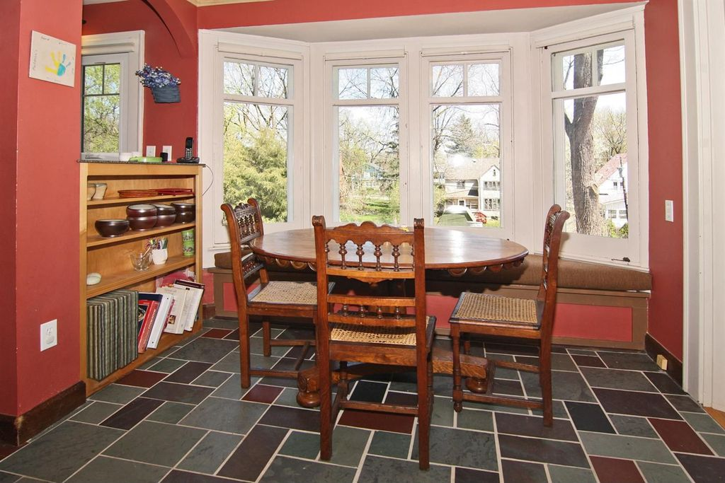 Traditional Dining Room With Slate Tile Floors Bay Window Built In Bookshelf