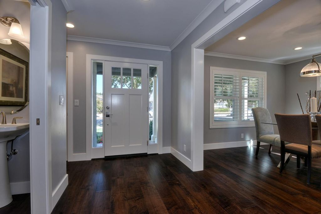 Traditional Room With Interior Plantation Shutters, HomeBASICS, Craftsman 3  Lite Painted Steel Prehung Front