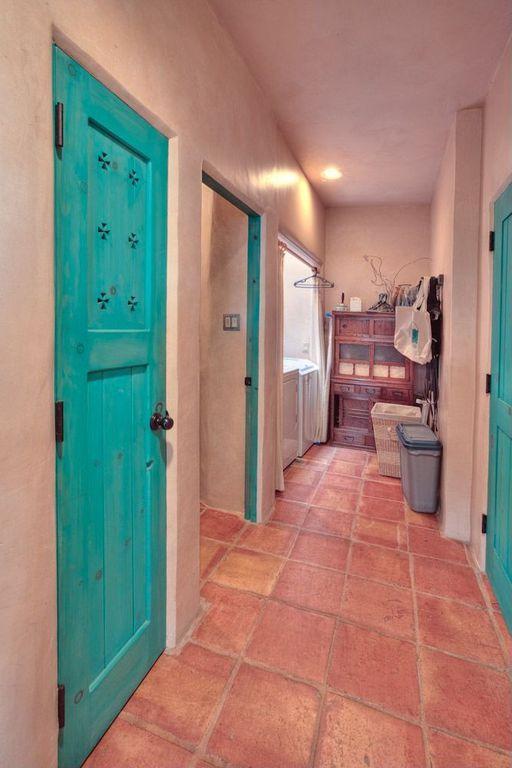 Laundry room with terracotta tile floors in santa fe nm for Southwestern flooring