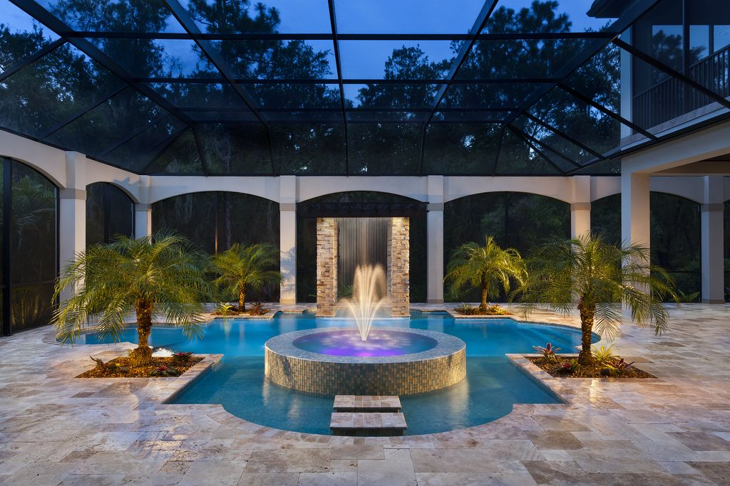 tropical swimming pool with pathway & exterior stone floors