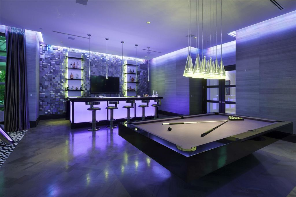 Modern Game Room With Chandelier Hardwood Floors In