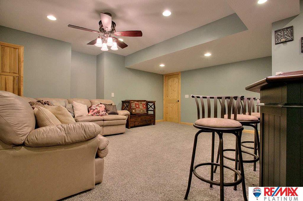 Basement Ceiling Fan : Rustic basement with carpet ceiling fan in omaha ne