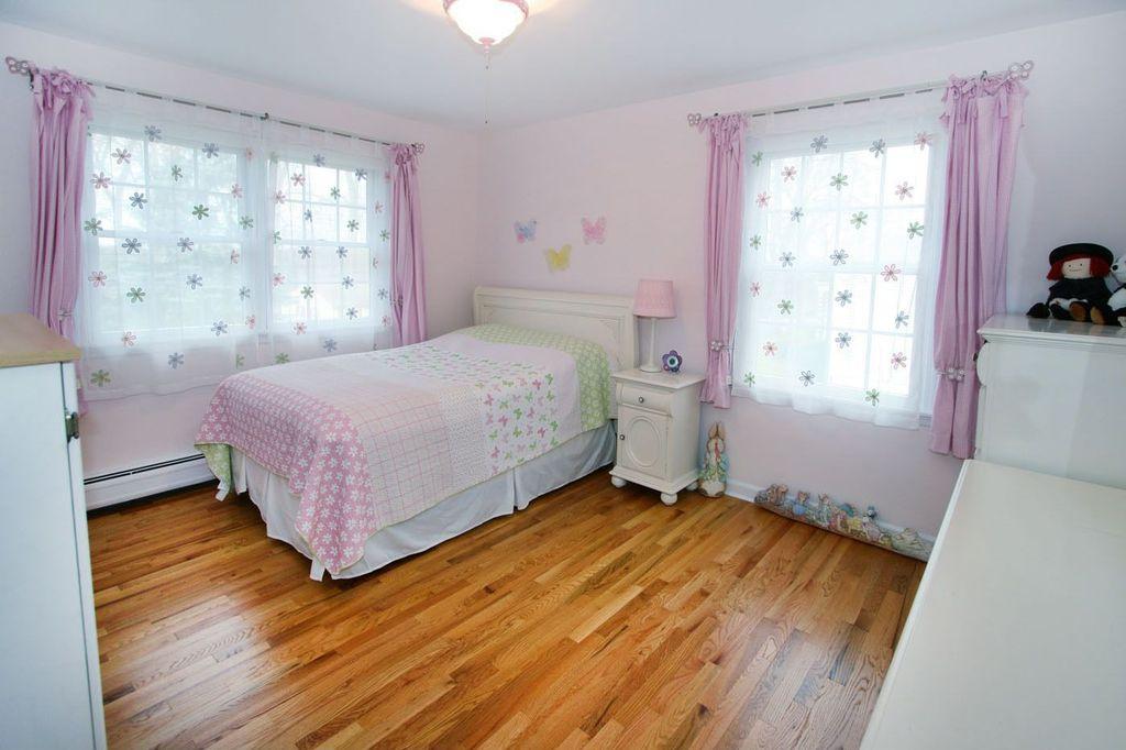 Kids Bedroom Flooring traditional kids bedroom with hardwood floors & flush light in new