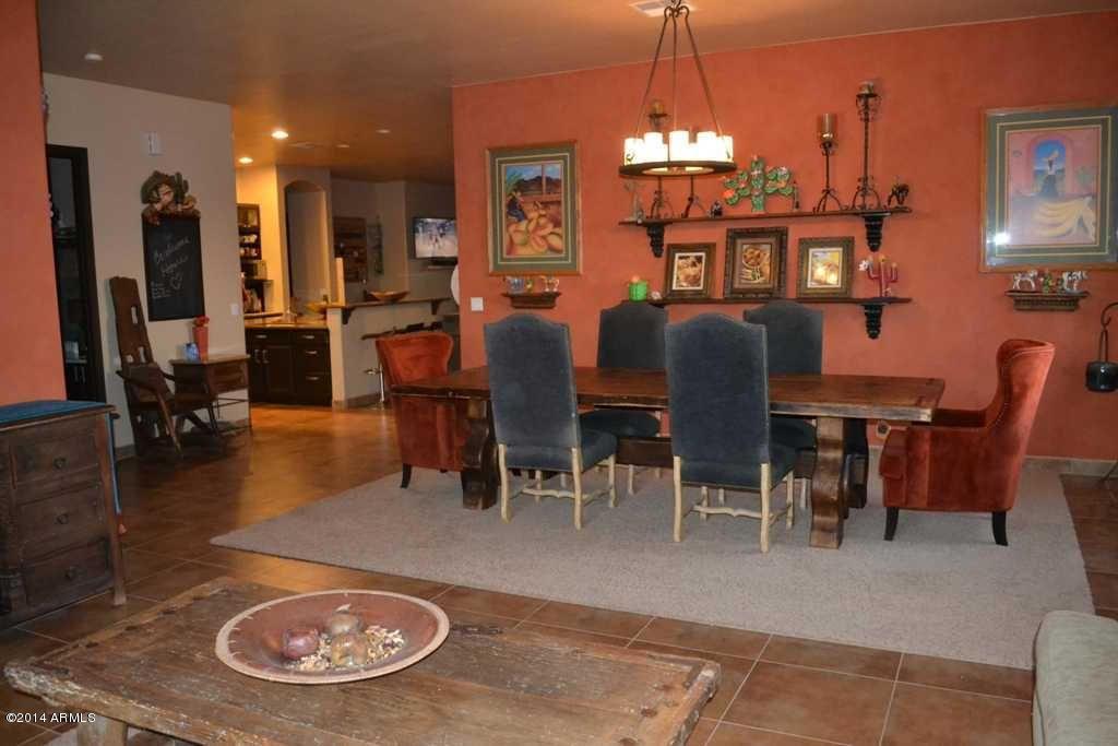 Southwestern Dining Room With Travertine Tile Floors Chandelier