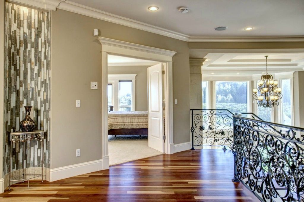 Art Deco Hallway with Hardwood floors  Crown molding  Metal staircase. Art Deco Hallway with Crown molding   Hardwood floors in Auburn