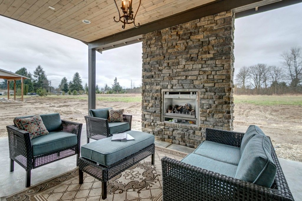 Contemporary Porch with Columns & stone fireplace in Lake Stevens ...