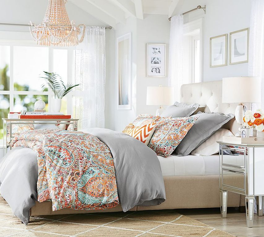 transitional master bedroom with jute lattice rug carpet emily chandelier limestone floors