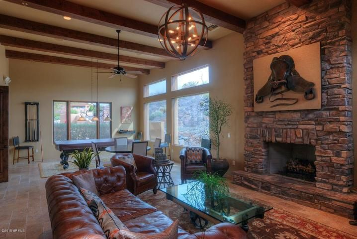 Rustic Great Room with stone fireplace & Chandelier in Cave Creek ...