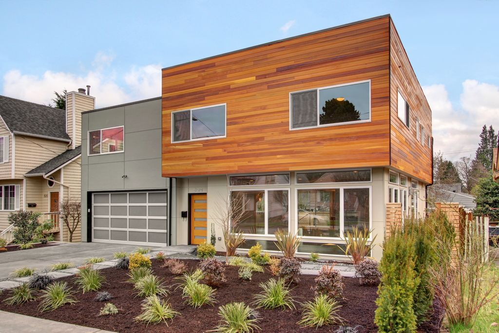 contemporary exterior of home with aluminum garage doors ornamental grass cedar siding - Modern Home Exterior Siding