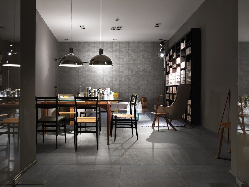 contemporary dining room with flush lightpental surfaces