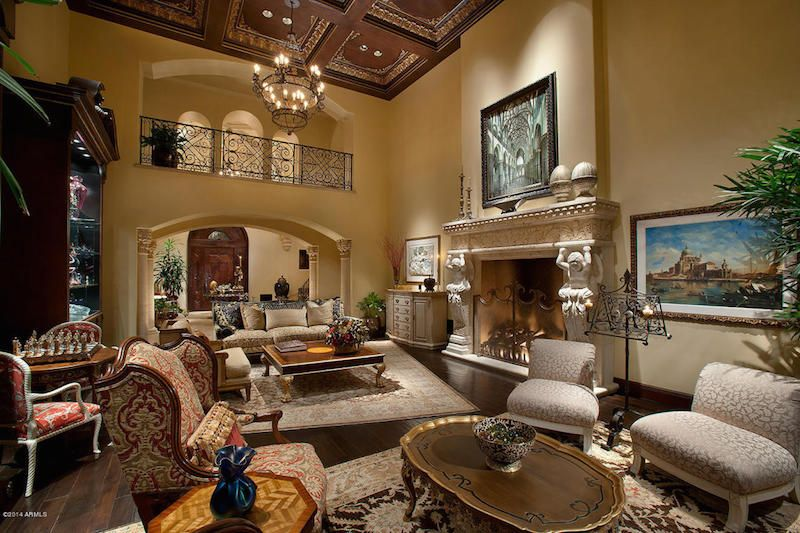 1 tag Mediterranean Living Room with Box ceiling  High ceiling  stone  fireplace  Balcony  Chandelier. Luxury Living Room Balcony Design Ideas   Pictures   Zillow Digs