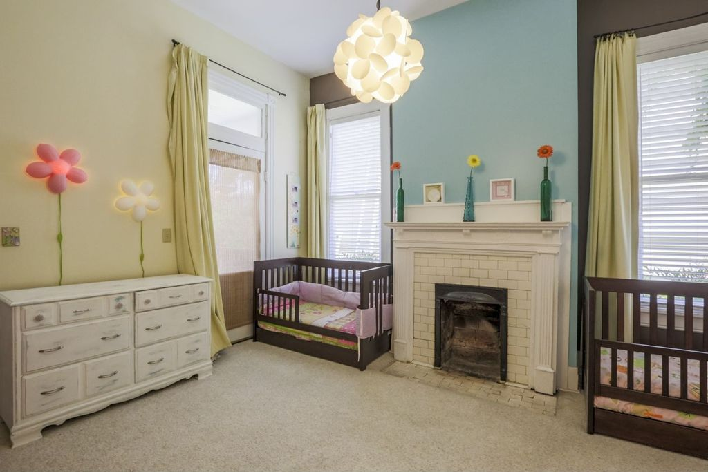 Modern nursery with transom window carpet zillow digs zillow modern nursery with transom window knappa pendant lamp white glass panel door mozeypictures Image collections