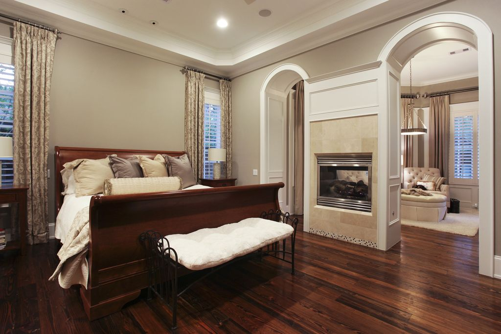 traditional master bedroom with hardwood floors by brickmoon design