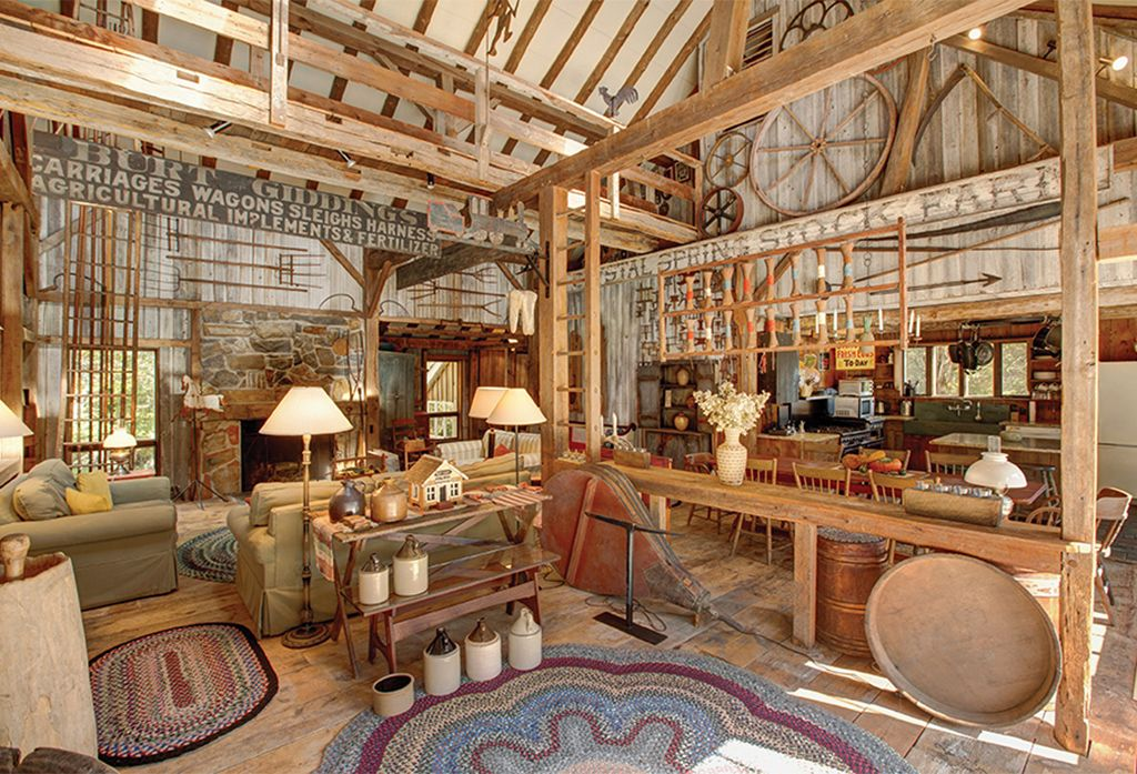 Rustic great room with chandelier by the corcoran group for Rustic great room