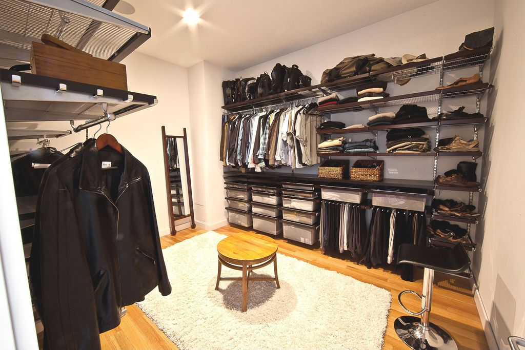 Contemporary Closet With Flush Light Walnut Elfa Decor Shelves Bamboo Floors