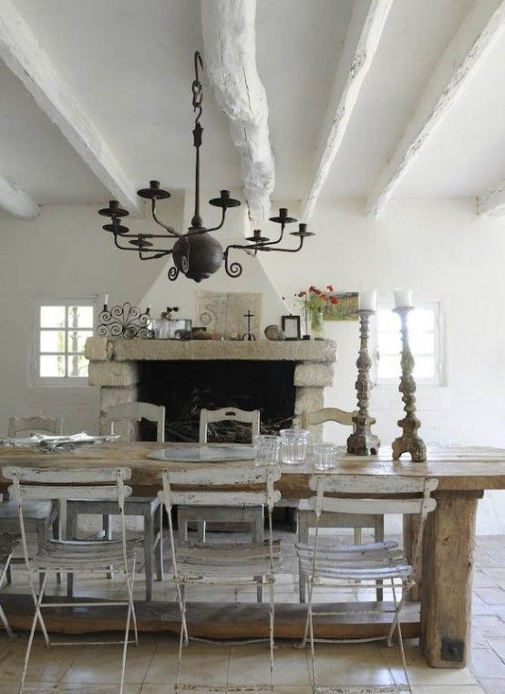 Rustic Dining Room With Exposed Beam Stone Fireplace Concrete Tile Chandelier