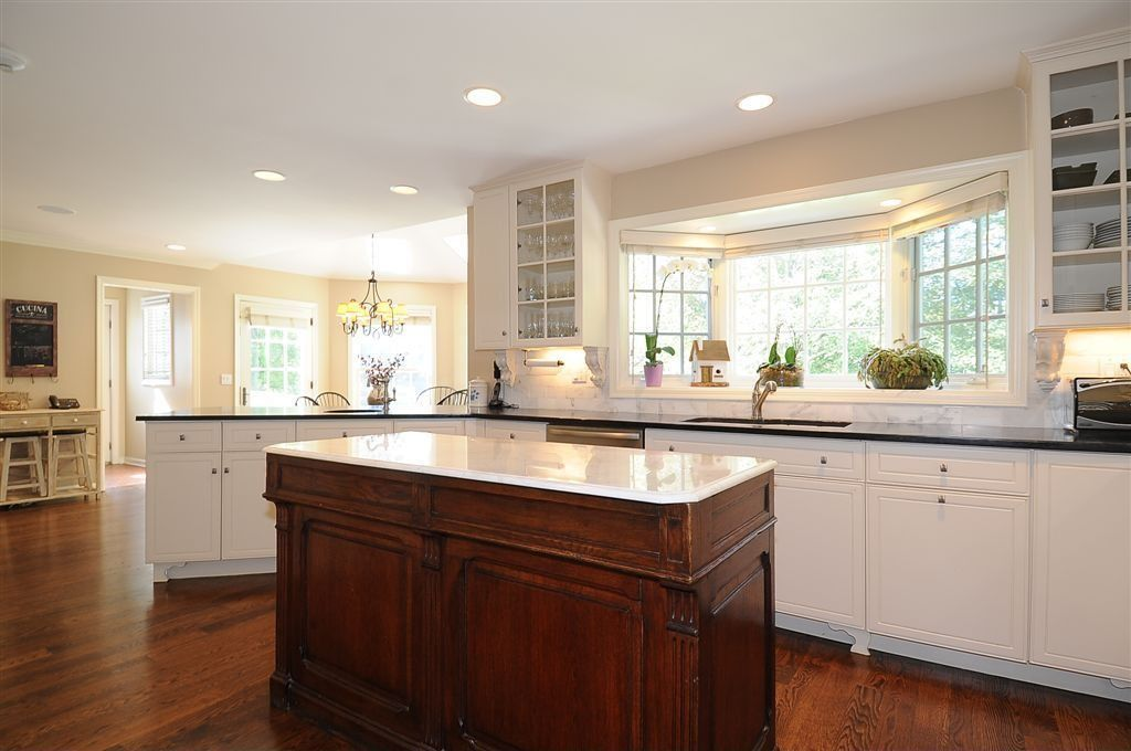 Traditional kitchen with glass panel flush in new canaan - Glass wall panels kitchen ...