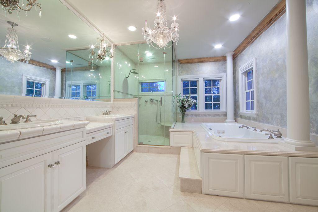 Traditional Master Bathroom With Large Ceramic Tile Frameless