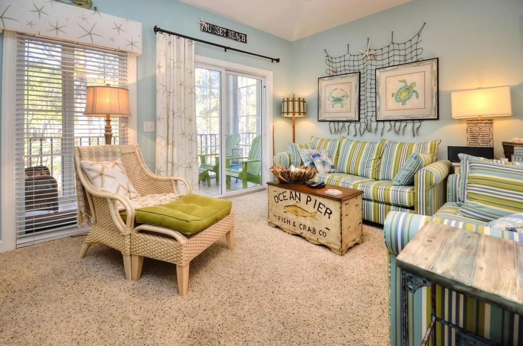 Traditional Living Room with Carpet by Laura Karriker Zillow