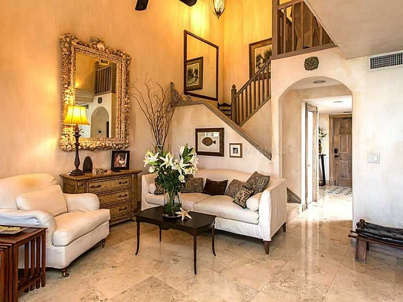 Mediterranean Living Room with travertine tile floors & Columns in ...
