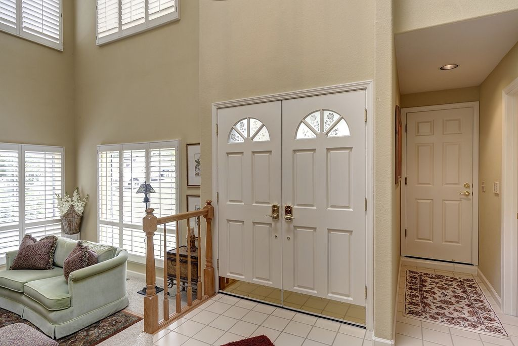 living room entryway. Traditional Entryway with Sunken living room  sandstone tile floors High ceiling travertine
