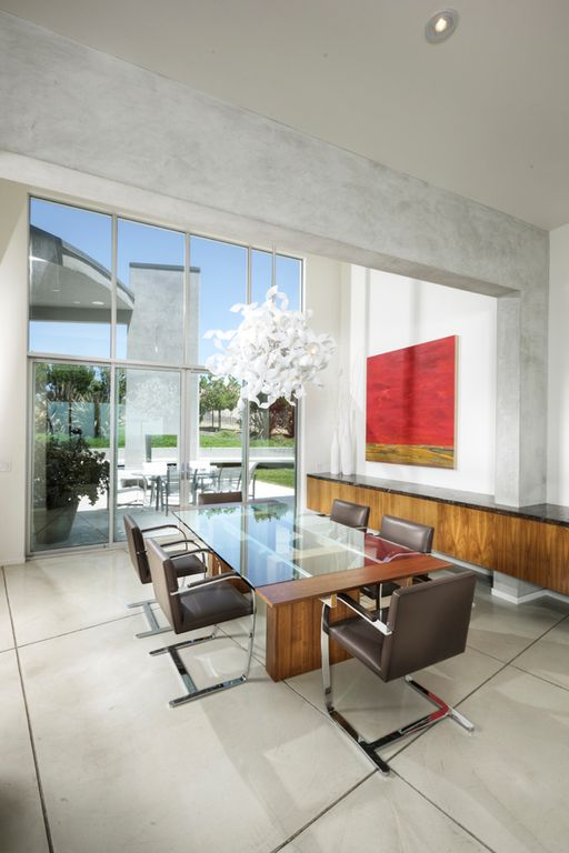 Modern Dining Room With High Ceiling Quoizel Ribbons Pendant Concrete Floors Chandelier