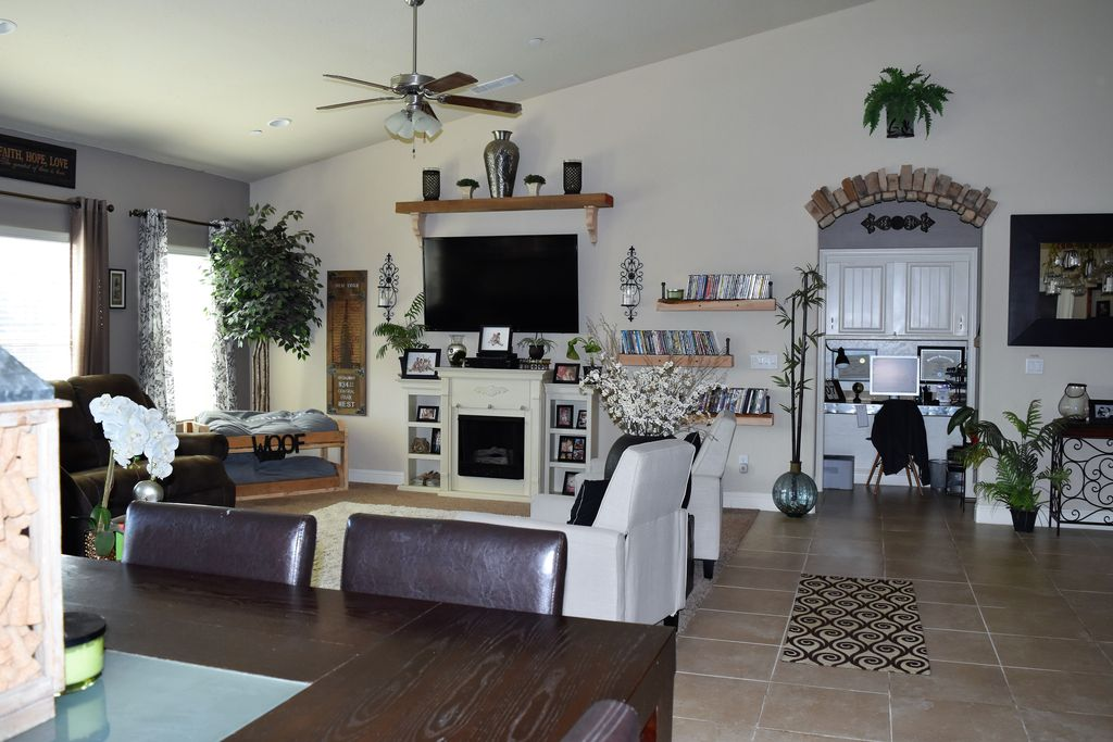 eclectic living room with carpet & ceiling fan in visalia, ca
