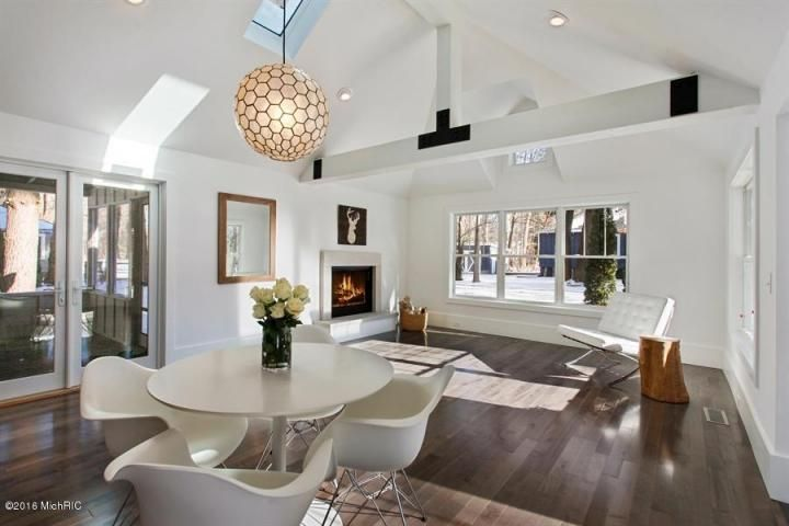 Contemporary Dining Room With Exposed Beam Metal Fireplace Skylight Cathedral Ceiling Pendant