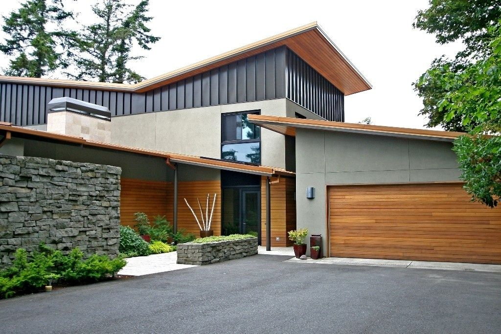 Modern exterior of home with stacked stone wall metal for Modern building colors exterior