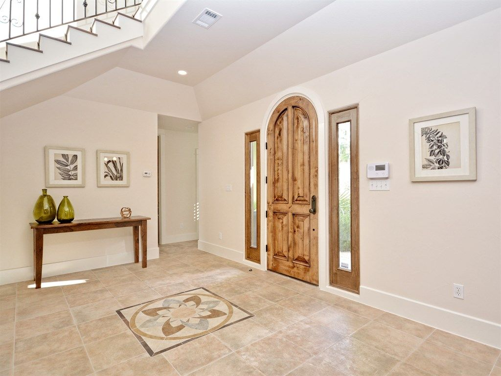 Traditional entryway with high ceiling limestone tile floors in traditional entryway with high ceiling limestone tile floors large olive bottle amish shaker dailygadgetfo Image collections