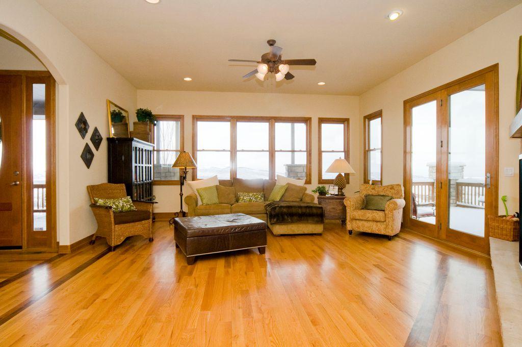 light hardwood floors living room. Craftsman Living Room with High ceiling  Ceiling fan flush light Hardwood floors in