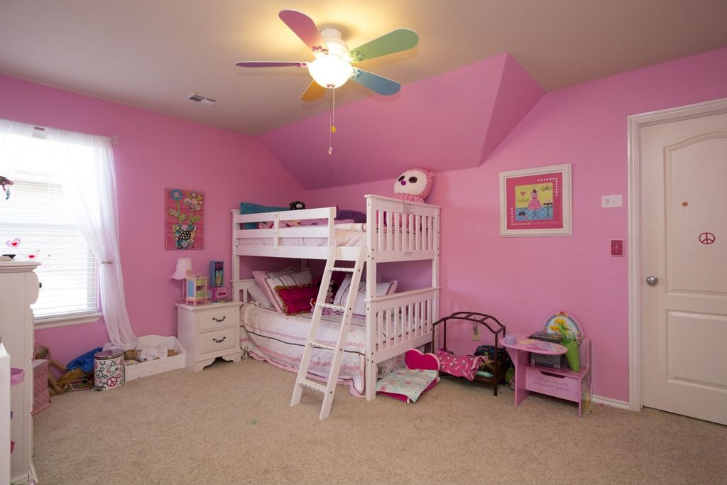 Traditional Kids Bedroom with Ceiling fan & specialty door in ...