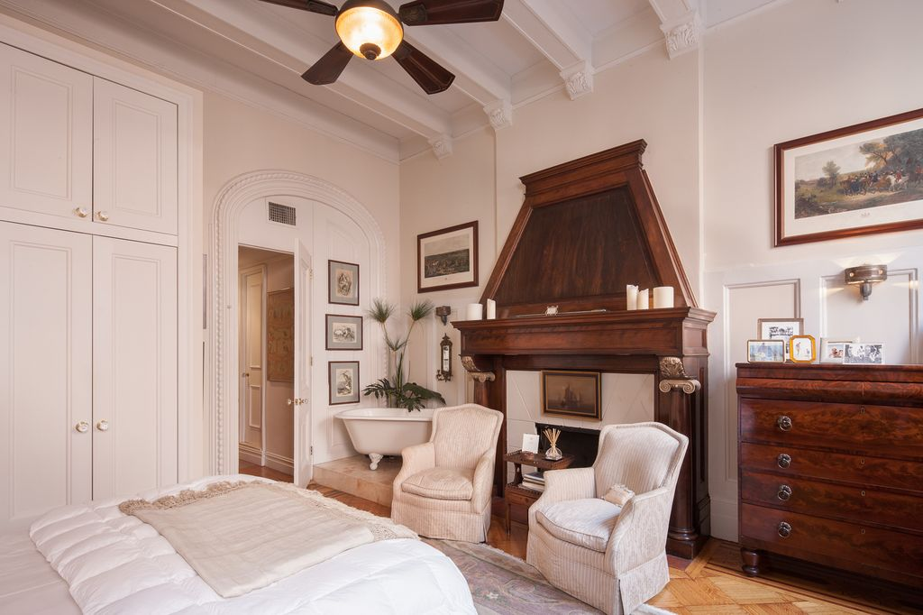 Traditional Master Bedroom With Crown Molding Exposed Beam Hardwood Floors High Ceiling