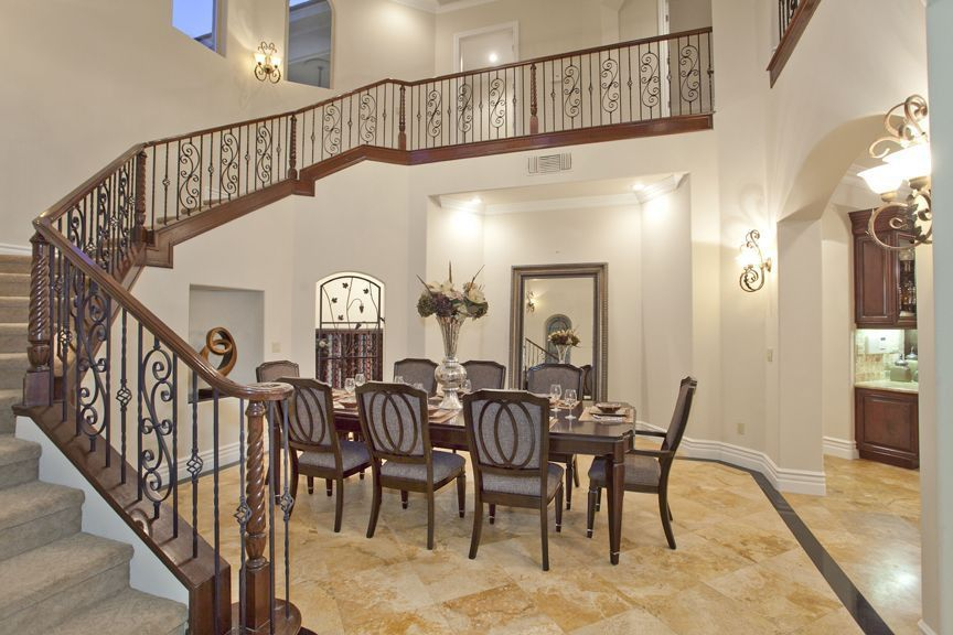 Mediterranean Dining Room With Arched Window, Wall Sconce, Travertine  Floors, High Ceiling
