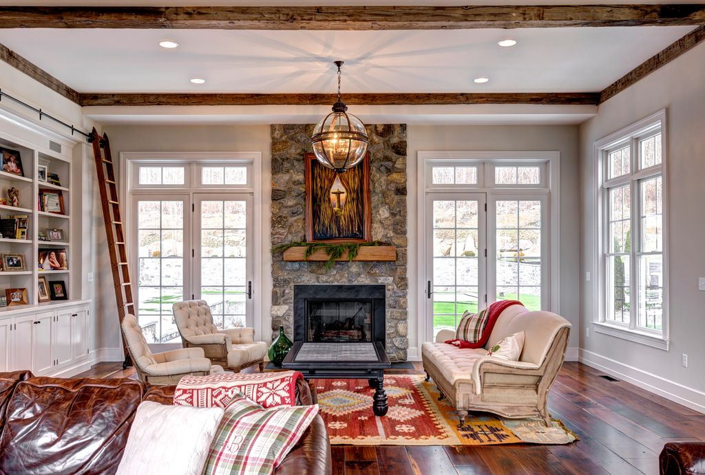 Traditional living room with river rock fireplace by don for Living room designs with french windows