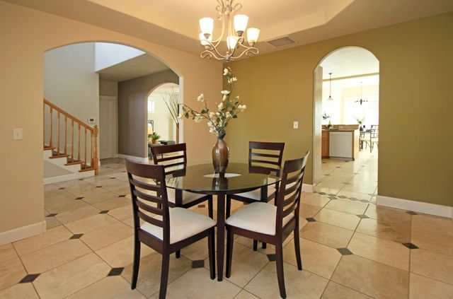 Contemporary Dining Room With Travertine Tile Floors Chandelier