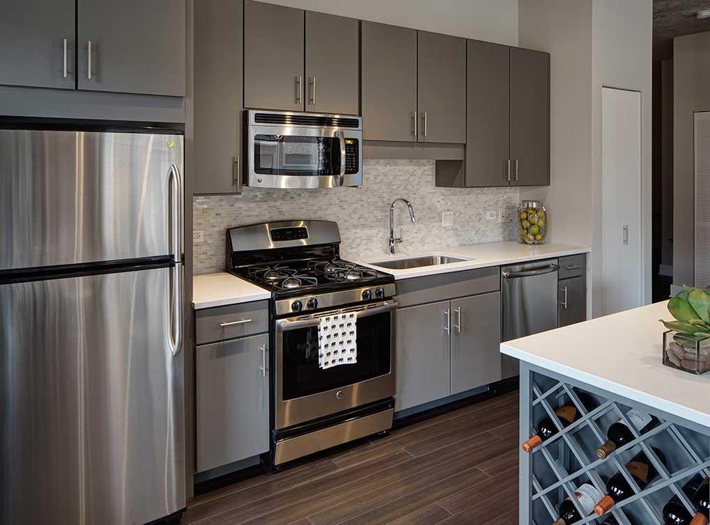 Contemporary Kitchen With Undermount Sink, Hardwood Floors, Takla Porcelain  Tile   Totem Series