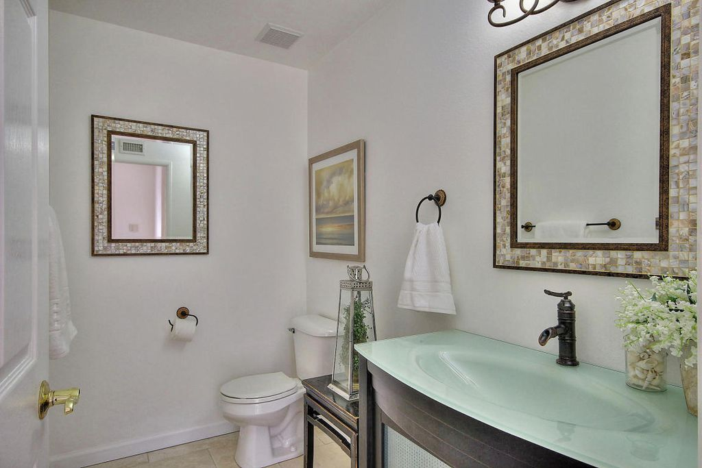 Transitional Powder Room With High Ceiling, Limestone Tile Floors, Inset  Cabinets, Glass Panel