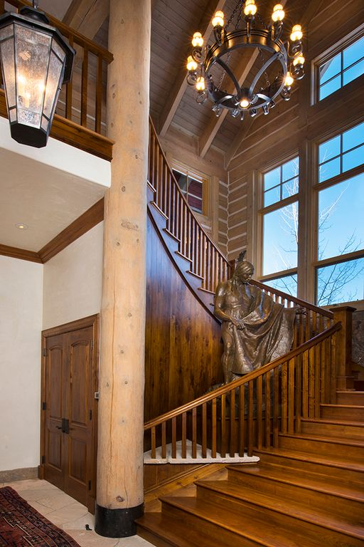 Rustic Staircase With Columns, Hardwood Floors, Cathedral Ceiling, Exposed  Beam, Chandelier