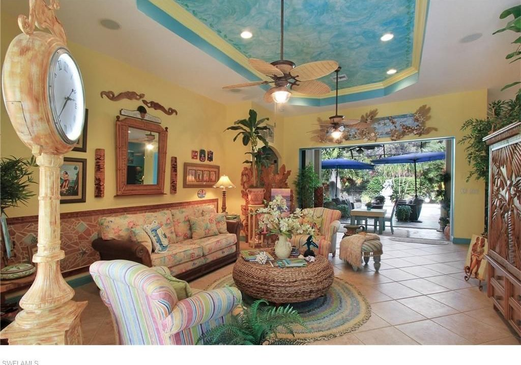 Tropical Living Room With Limestone Tile Floors, Carpet, Flush Light, High  Ceiling,