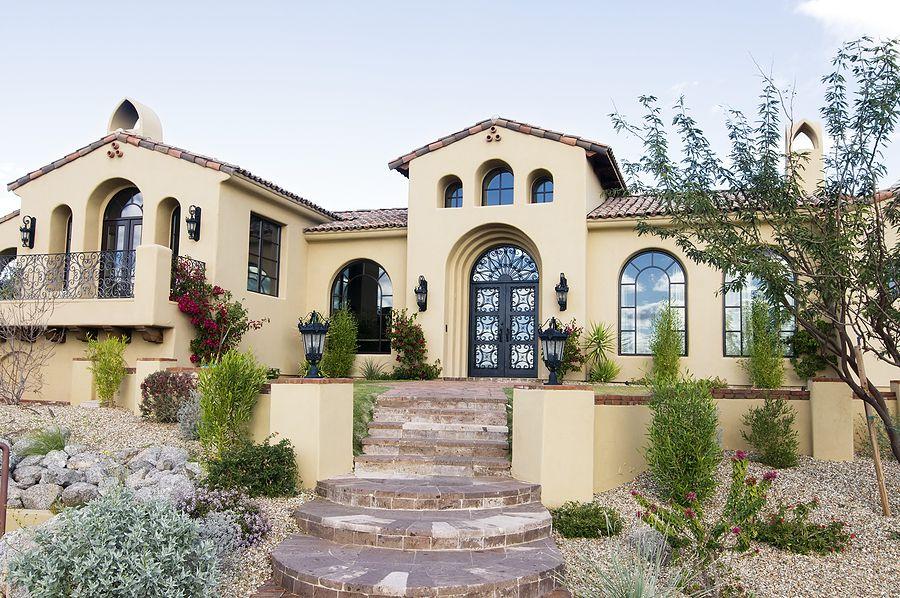 Mediterranean Exterior Of Home With Abby Iron Doors Custom Wrought Iron Door,  Bergerac Circle Pavers