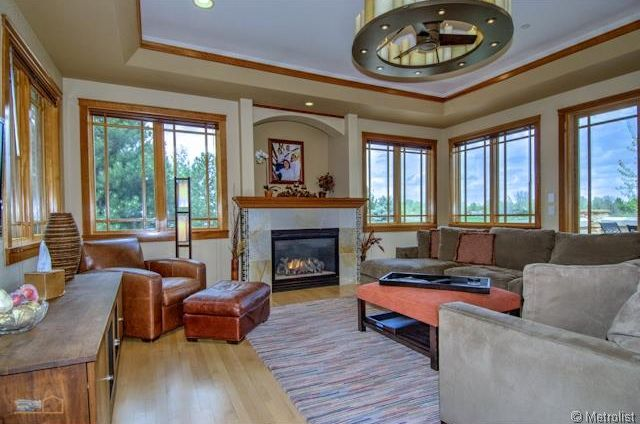 Craftsman living room with stone fireplace by ken caiani Floor to ceiling windows price
