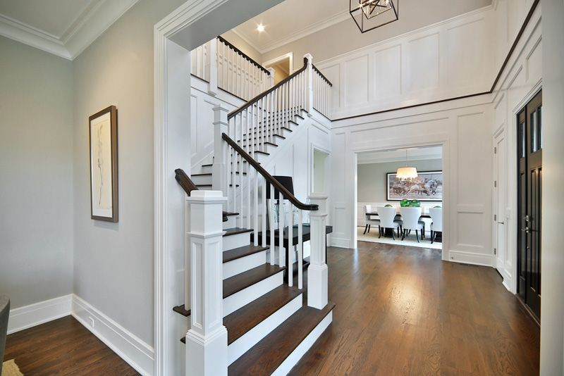 Traditional Entryway With Pendant Light Hardwood Floors In
